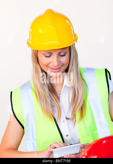 Worker with hard hat looking at drawing - Stock Image