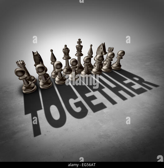 Together concept and team effort symbol as a group of chess pieces in a set casting a shadow with the word representing - Stock-Bilder