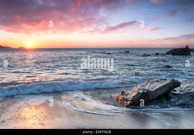 Beautiful beach at sunset - Stock Image
