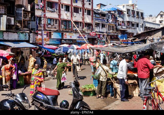 Mumbai India Asian Apollo Bandar Colaba Causeway Market Lala Nigam Road shopping street vendors stalls vegetables - Stock Image