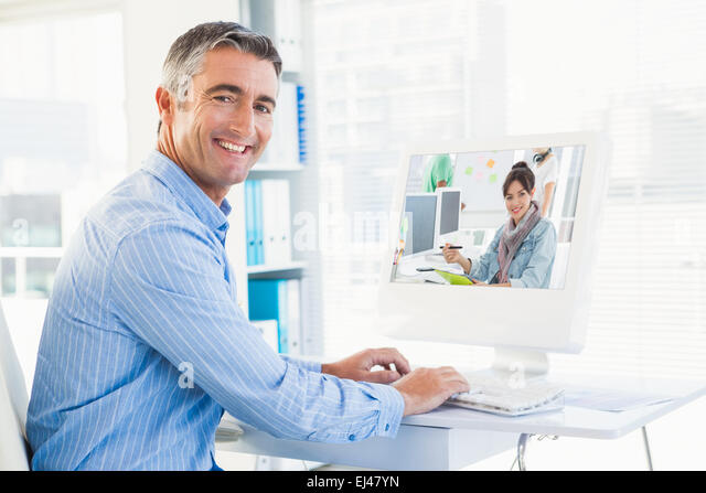 Composite image of artist drawing something on graphic tablet with colleagues behind - Stock-Bilder