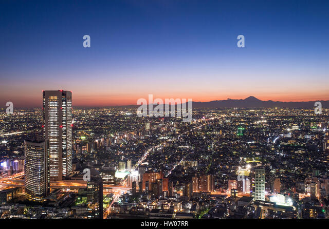 Tokyo city at twilight with Mt Fuji on the background - Stock Image