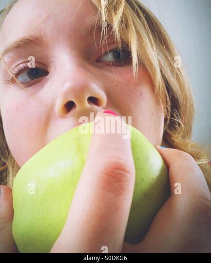 Eating apple - Stock Image