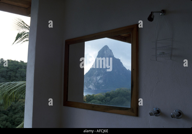 West Indies St. Lucia Anse Chastanet Resort Royal Palm room 7F shower mirror reflection Petit Piton mountains - Stock Image