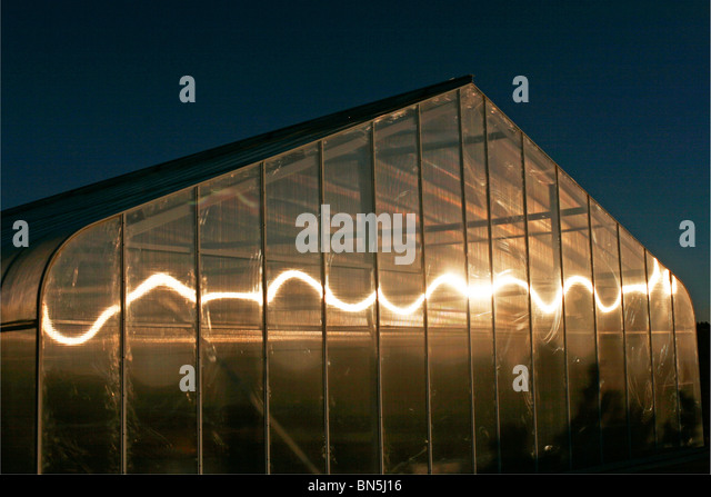 Garden greenhouse with swirl reflection - Stock Image