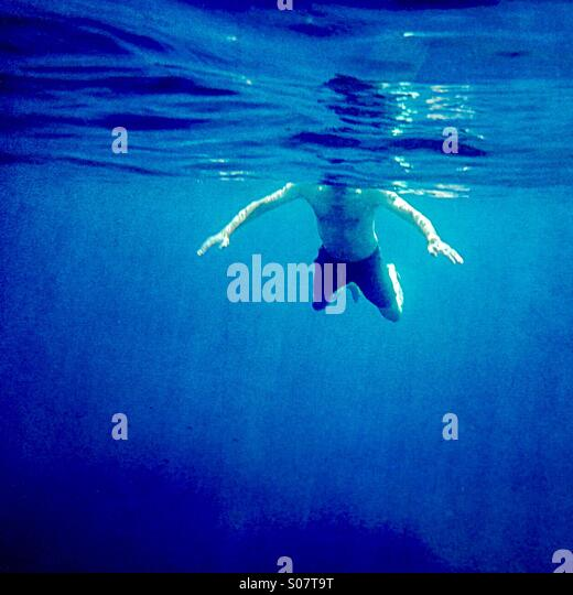 Shark attack !                                               A man swimming viewed from underwater - Stock Image