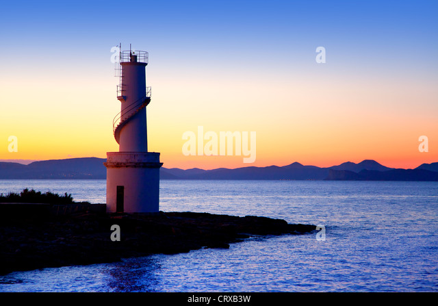 Ibiza island sunset of Es Vedra and La Savina lighthouse in Formentera - Stock-Bilder