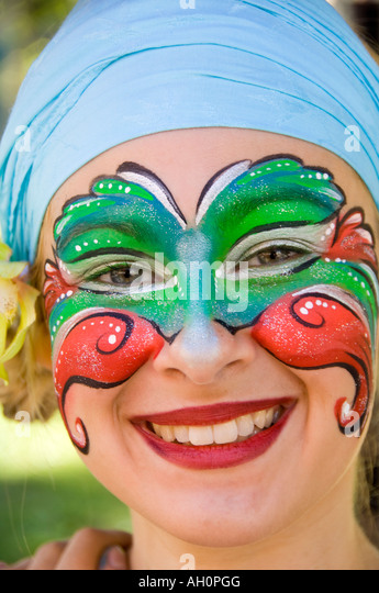 Canada Quebec Old Quebec city Place d Armes Portrait of attractive woman face painter - Stock Image