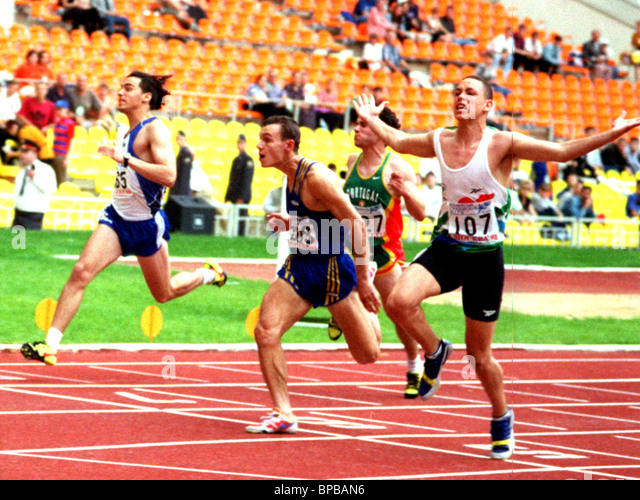 The World Youth Games. Athletics. Paul Gorries of RSA (R) became the Winner in 100 m track events(10,76). - Stock Image