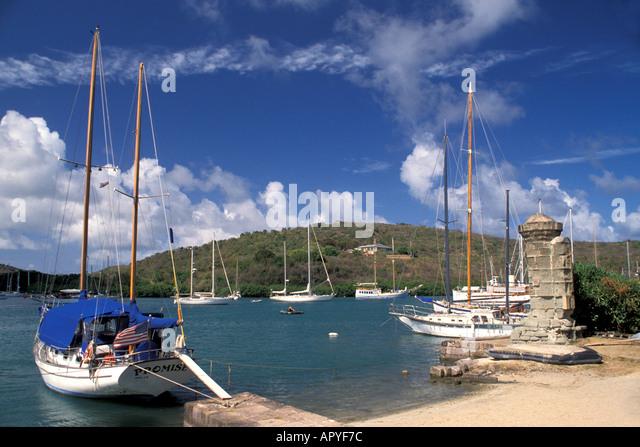 Antigua Nelsons Dockyard National Park sailboats near boat slip and round column, English Harbour Sailboats - Stock Image