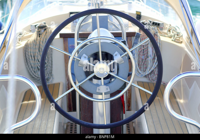 boat rudder wheel white sailboat detail beautiful yacht - Stock Image