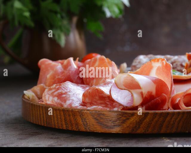 Assorted deli meats - ham, sausage, salami, parma, prosciutto, bacon - Stock Image