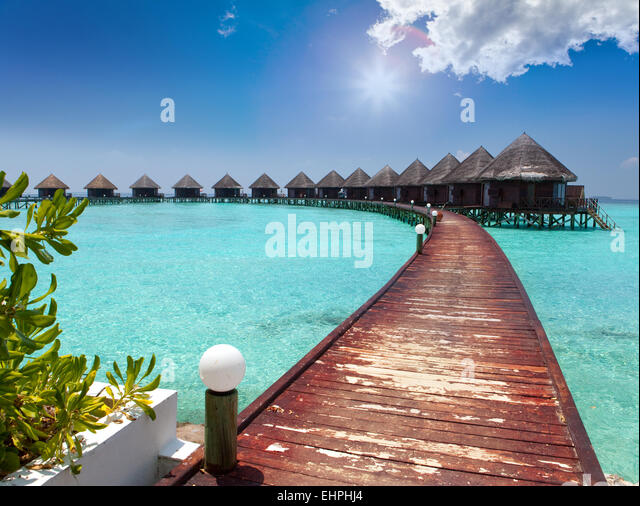 houses on piles on sea. Maldives. - Stock-Bilder