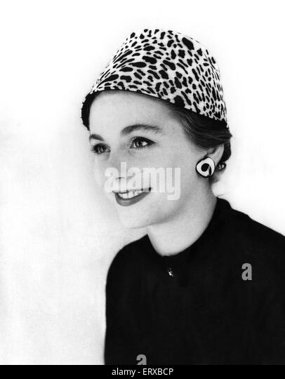 A woman modelling an animal print hat. 13th September 1955 - Stock Image