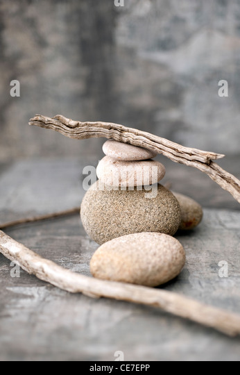Sticks and Stones in a neutral tone studio environment. - Stock Image