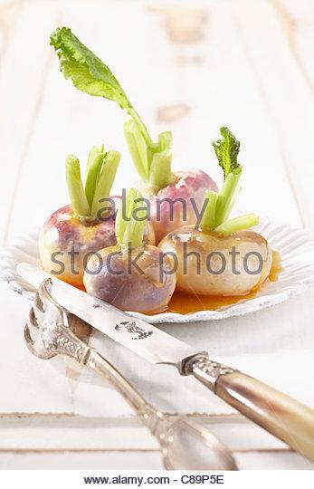 Turnips glazed with honey and cinnamon - Stock Image