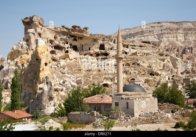 mosque and rock homes, cavusin village, landscape, cappadocia, anatolia, turkey, asia - Stock Image