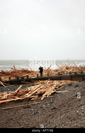 Piles of wood from the wreckage of the cargo ship 'Ice Prince'. Worthing beach, West Sussex, UK. - Stock Image