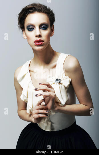 Luxury. Magnetism. Eccentric Fashion Model in Trendy Dress. Character - Stock Image