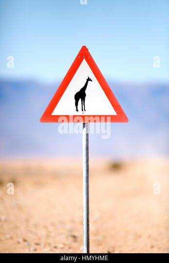 Caution sign in the Namibian desert - Stock Image