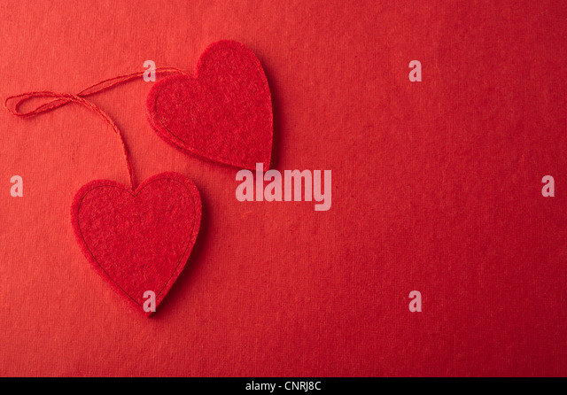 Heart ornaments on red background - Stock-Bilder