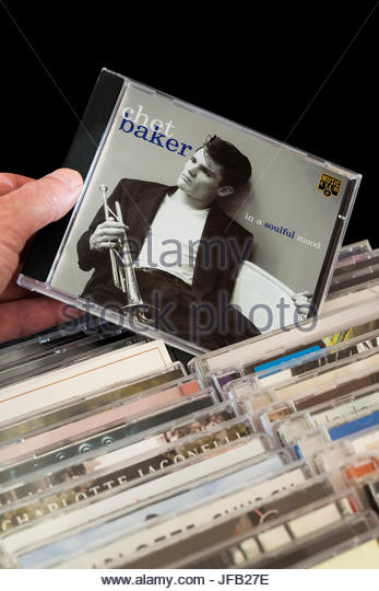In a Soulful Mood, Chet Baker CD being chosen from among rows of other CD's, Dorset, England - Stock Image