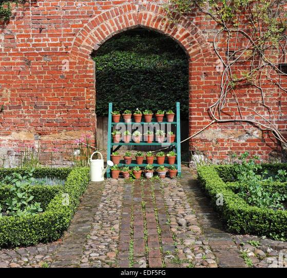 Red brick garden archway stock photos red brick garden for Red brick garden