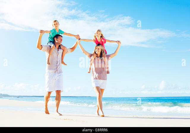 Photo of Happy Family Having Fun on the Beach. Summer Lifestyle. - Stock Image