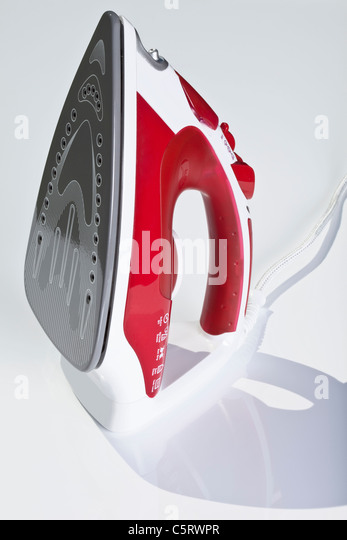 Close up of steam iron against white background - Stock Image