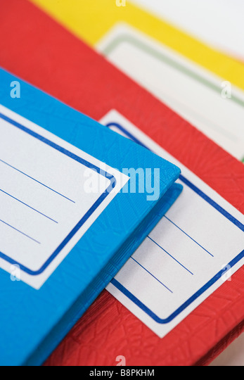 Pile of school notebooks with blank labels - Stock Image