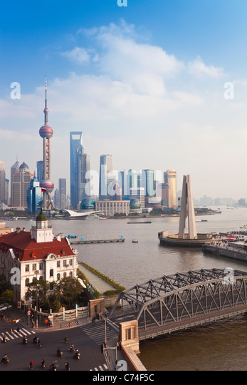 New Pudong skyline Waibaidu (Garden) Bridge looking across the Huangpu River from the Bund Shanghai China - Stock Image