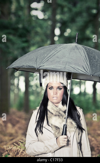 Shot of Attrractive Teen in Forest in the Rain - with Umbrella - Stock-Bilder