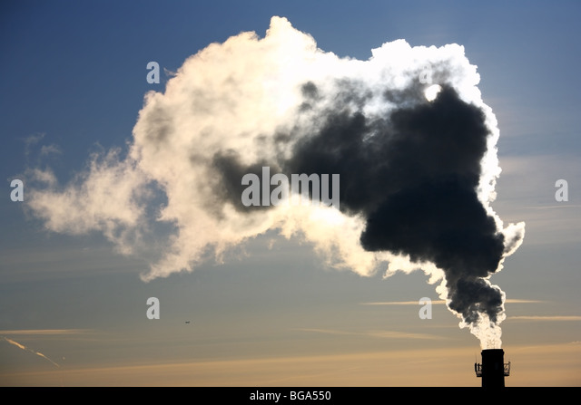 Pollution. Thick smoke from the chimney in winter morning. - Stock Image