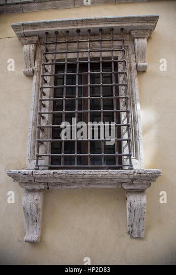 Inglese     Italiano Old window with bars - Stock Image