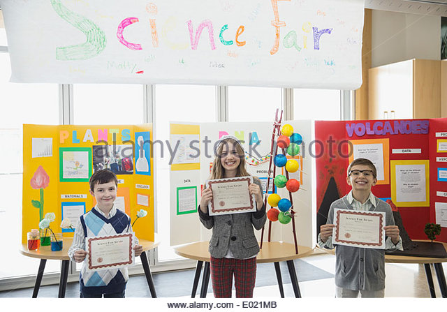 Elementary students with awards at science fair - Stock Image