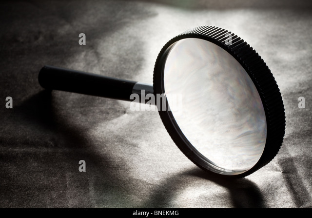magnifying glass on Black background - Stock Image