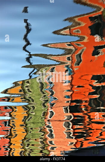 Colorful houses (reversed reflection) of picturesque Burano island, Venice, Veneto, Italy. - Stock Image