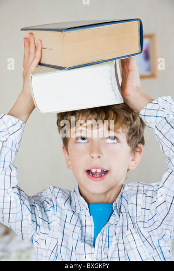 Boy with books - Stock Image