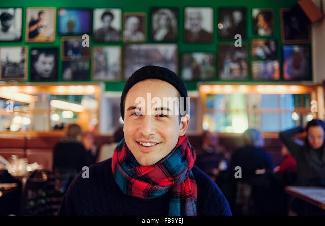 Sweden, Stockholm, Sodermalm, Smiling man at pub - Stock Image