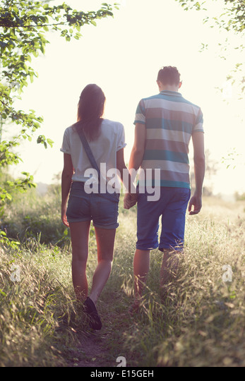 walking loving couple at sunset - Stock-Bilder