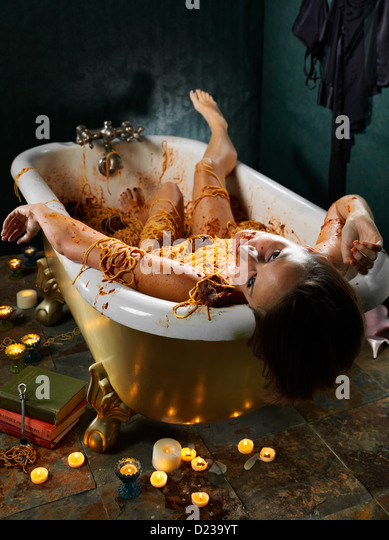 Food Crime scene with death by gluttony. - Stock Image