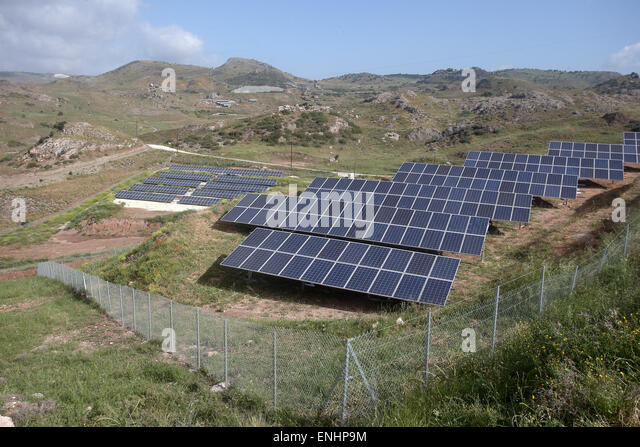 Solar panels in a field on hillside, Cyprus - Stock Image