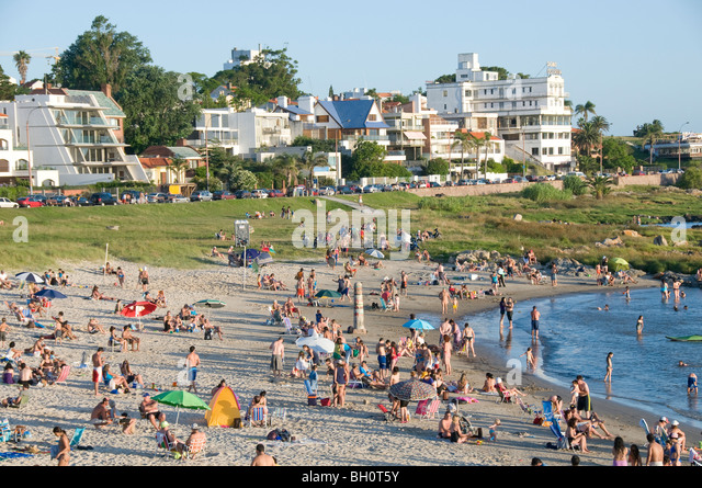 Uruguay. People sunbathing at Punta Gorda beach in Montevideo, - Stock Image