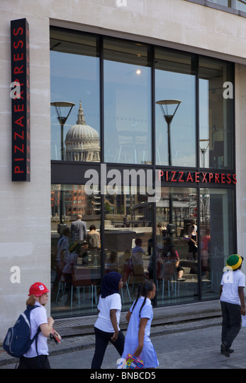 Pizza Express on bank side London with St Paul's Cathedral in the reflection - Stock Image