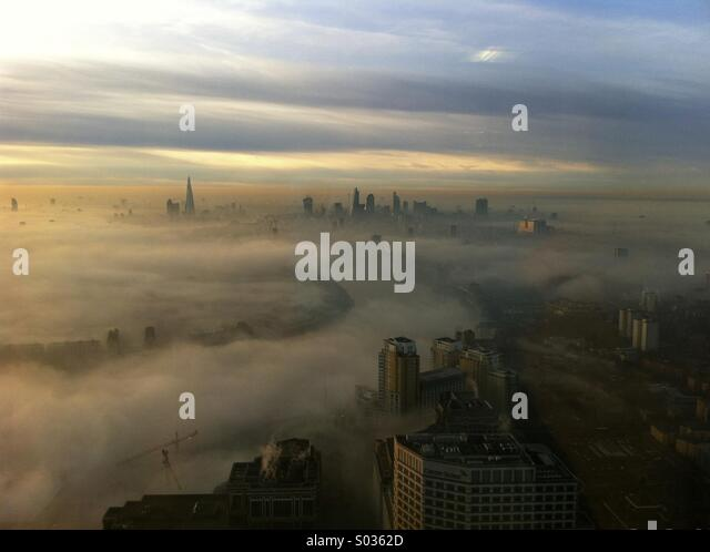 London skyline sunset with fog from high viewpoint - Stock Image
