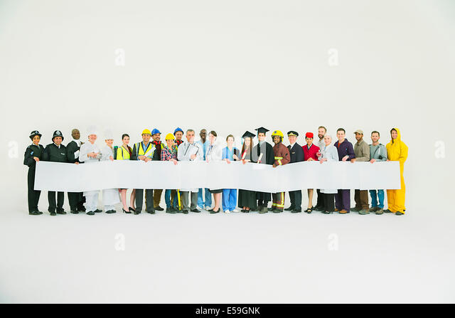 Diverse workforce holding signs - Stock Image