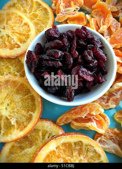 Dried fruits on a plate. - Stock Image