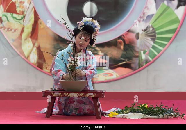 Geisha  perforMS an ikebana ceremony at the Oriental festival in Turin,Italy - Stock Image