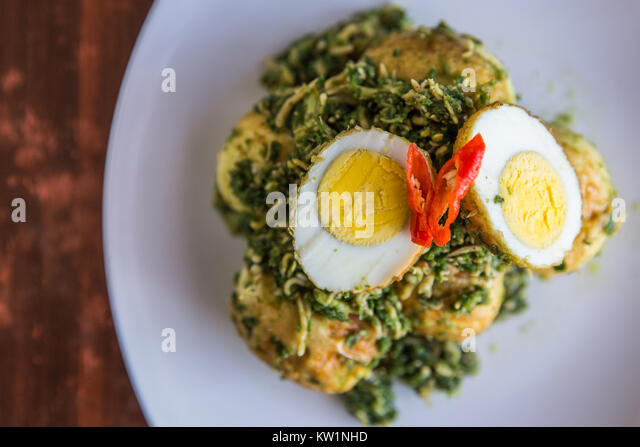 Adding anchovy into stir-fry egg and green chili sauce - Stock Image