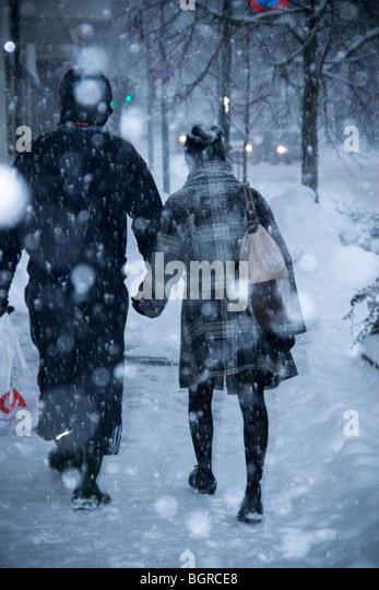 Couple walking in heavy snowing in Oslo, Norway. - Stock Image